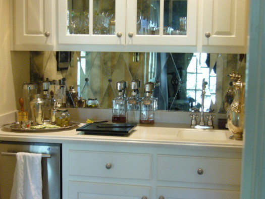 i can't resist this antiqued mirror tile backsplash